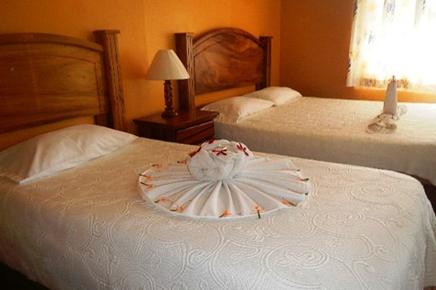 Caribbean Paradise – Standard-Zimmer: Betten