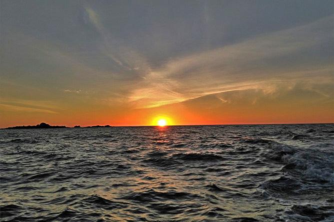 Isla Violin Sonnenuntergang über dem Meer